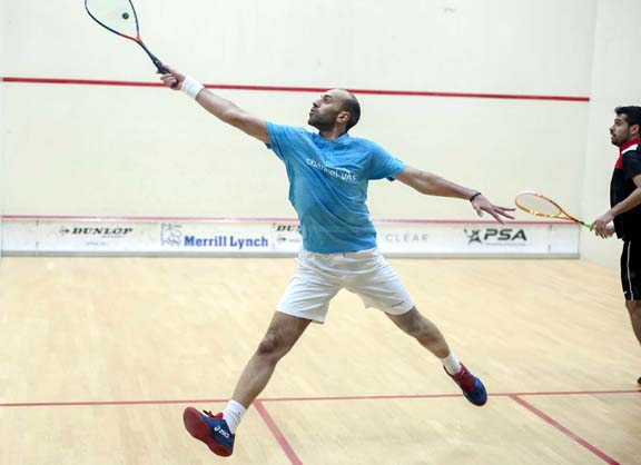 Top seed Marwan ElShorbagy of Egypt shows his ballet form on the way to defeating Mexico's Arturo Salazar in the MCO first round.. (Photo by Bryan Mitchell for MCO)